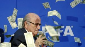 Banknotes-are-thrown-at-FIFA-President-Blatter-as-he-arrives-for-a-news-conferen[1]